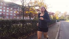 Woman Running in Park in the Autumn Stock Footage