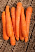 Farm fresh whole carrots Stock Photos