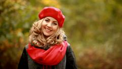 Portrait of beautiful blond girl in park Stock Footage