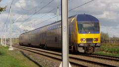 Dutch Railway Intercity passing crossing Stock Footage