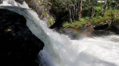 Waterfalls with a strong current making water sprays being sprayed on the Stock Footage