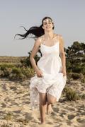girl with white long dress running - stock photo