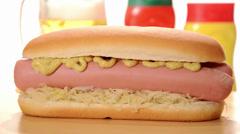 Hotdog, mustard, ketchup and beer Stock Footage