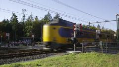 Dutch Railways Intercity passing railroad crossing Stock Footage