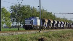 A VolkerRail cargo train with empty gravel wagons Stock Footage