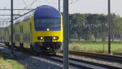 Teleshot of a Dutch Intercity train driving towards camera Stock Footage