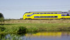 Dutch Railways Intercity train passing by Stock Footage