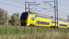 Dutch Railways VIRM passing by Stock Footage