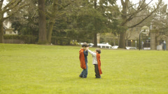 Little Boys Play Superheroes In The Park Stock Footage