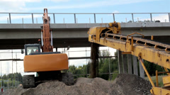 Bulldozer busy loading and unloading heaps of soil sand roadwork Stock Footage