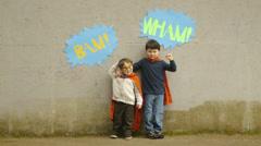 Superhero Boys Pose and Fly Stock Footage