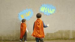 Little Boy Superheroes Try To Knock Down Wall Stock Footage
