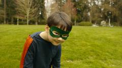 Curious Superhero Boy Runs Away From Camera Stock Footage