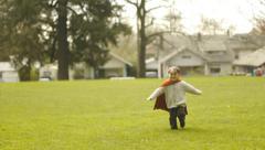 Little Superhero Runs In The Park Stock Footage