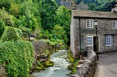 River and cottage in Castleton,Derbyshire Stock Photos
