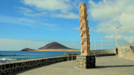 Stock Video Footage of El Medano view to Montaña Roja (Red Rock) in Tenerife, Canary islands.