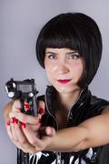modern pin-up girl holding a gun - stock photo