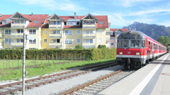 Electric subway train moving from the main train station of Fussen, Germany Stock Footage