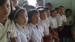 Stock Video Footage of Indonesian Kids Smiling and Clapping Hands