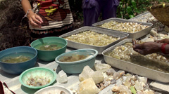 Tourists are considering raw semi-precious stones from the mine. Stock Footage