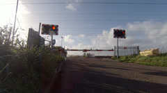 East Coast Mainline train passing a railway level crossing - stock footage