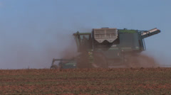 Harvester against skyline Stock Footage