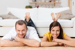 happy relaxed couple smiling at the camera - stock photo