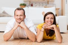 Lazy attractive young couple unwinding at home Stock Photos