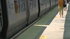 Boarding a commuter train (5 of 6) - stock footage