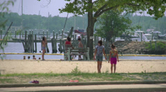 Playing on the beach (3 of 8) - stock footage