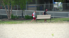 Playing on the beach (1 of 8) - stock footage