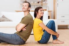 young couple relaxing on the floor at home - stock photo