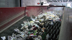 Trash on a wheel conveyor (1 of 8) Stock Footage