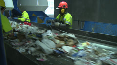 Trash workers weeding through recyclables (2 of 10) Stock Footage