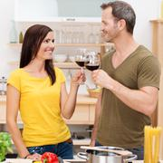 young couple toasting each other - stock photo