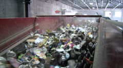 Trash on a wheel conveyor (3 of 8) Stock Footage