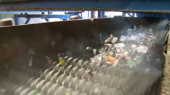 Trash on a wheel conveyor (4 of 8) Stock Footage