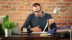 Worried man looking at bad results in the documents Stock Footage