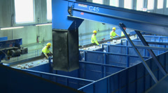 Assembly line of waste workers (1 of 2) Stock Footage