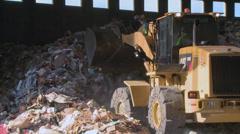 Bulldozer handling waste (3 of 9) - stock footage