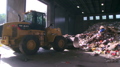 Plow pushing heap of trash (4 of 10) - stock footage