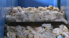 Close up of recyclables on a cleated conveyor (4 of 8) Stock Footage