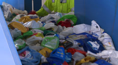 Close up of recyclables on a cleated conveyor (2 of 8) Stock Footage