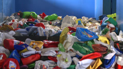 Close up of recyclables on a cleated conveyor (5 of 8) Stock Footage