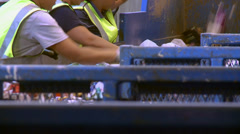 Hard-working recycling workers (3 of 5) - stock footage