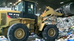 Bulldozer handling waste (1 of 9) - stock footage