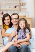 pretty little girl with her proud parents - stock photo