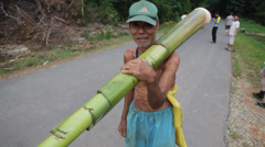 Old Man Carrying a Bamboo Tree, Indonesia Stock Footage