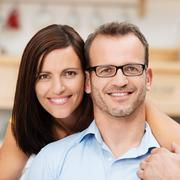 Attractive happy married couple Stock Photos