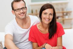 confident friendly young couple - stock photo